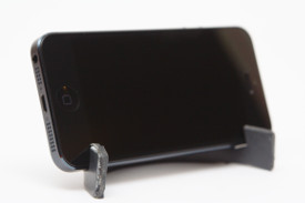 The iPhone stand with the phone, shown at an angle.